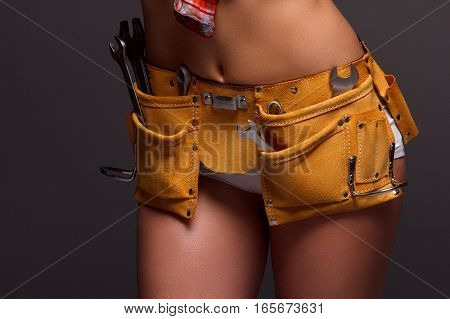 Female Construction Worker With Tool belt. Close up view.