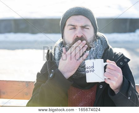 Yawning Man Drinks From Cup