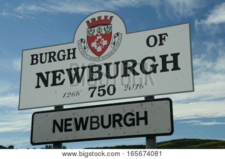 A view of the entrance to Newburgh sign