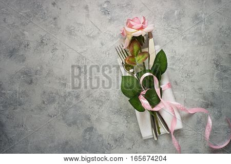 Valentines day table setting with rose flower. Top view copy space.