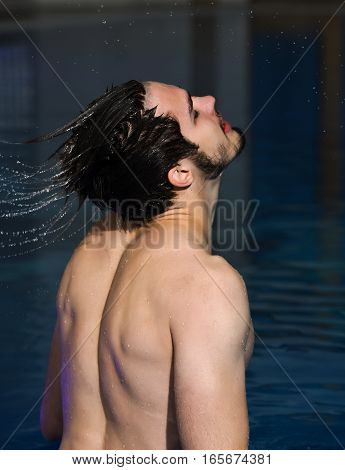 Man Splashes Water From Hair