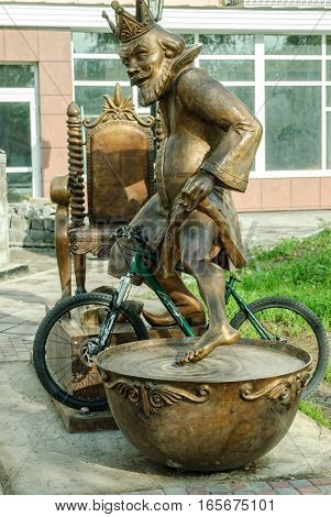 Tobolsk, Russia - May 2, 2010: Monument to the Tsar from the fairy tale Konek-Gorbunok of Yershov with joke from biker