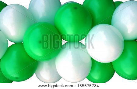 Garlands fragment consisting of inflatable green and white balls