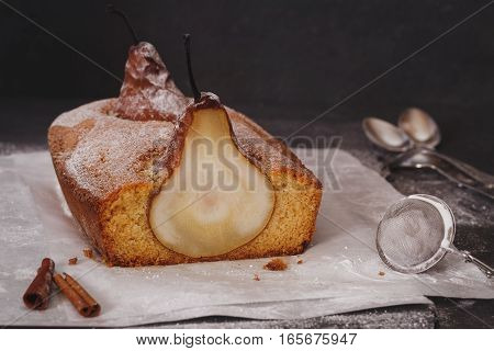 Pear loaf cake with whole pears baked inside. Macro, selective focus, vintage toned image, copy space