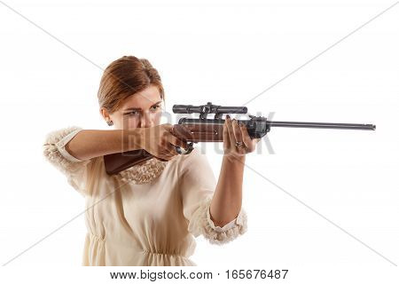 A young woman aiming an old rifle
