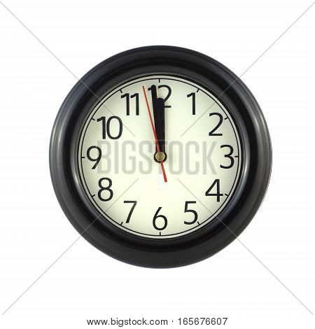 Round wall clock shows almost twelve hours isolated on white close up