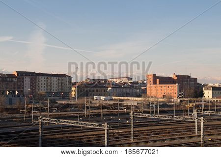 Italy Turin - January 5 2015: view of railways typical buildings and white mountains on background on January 05 2015 in Turin Italy.