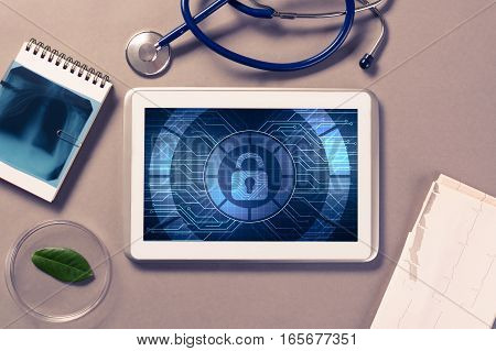 Doctors workplace with white tablet stethoscope and x-ray