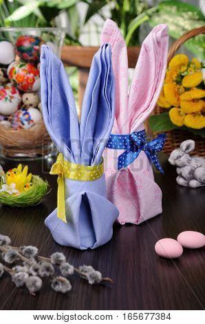 Napkin folded as an Easter bunny on a table