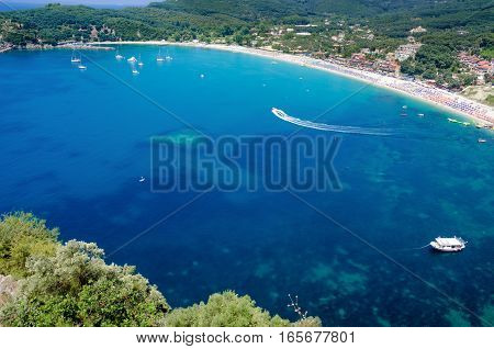 Beautiful aerial view of blue water bay with boats near Valtos beach Greece