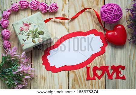 Postcard on valentine's Day with a frame and hearts