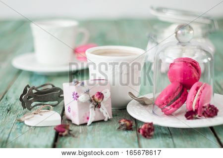 French Macaroons Cookies Gift Box And Cappuccino Cup On A Wooden Background. Mothers Day Or Valentin