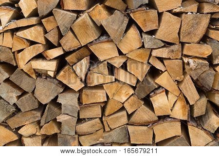Closeup of wooden stacks for firewood in winter