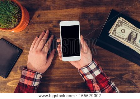 Woman using smart phone mock up screen as copy space top view of office desk