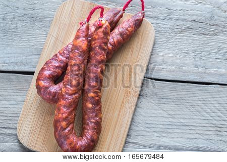 Chorizo on the wooden board: top view