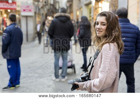 Girl In The Streets Of Toledo Walking With Her Camera.