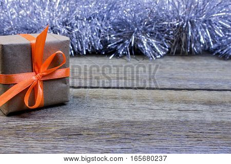 Boxes Gift, Paper Wrapping On The Wooden Table. On A Background Of Silver Tinsel