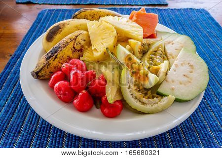Plate with various juicy ripe exotic tropical fruits