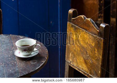 cup of coffee on rustic vintage table in El Jardin Colombia