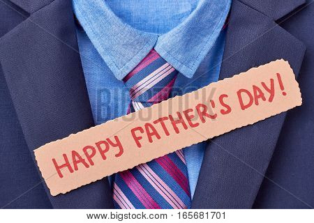Tuxedo and Father's Day card. Greeting paper and striped necktie. Male fashion example.