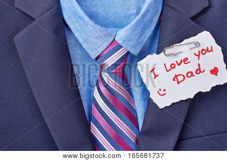 Necktie and Father's Day card. Tuxedo and inscription on paper. Elegant present for daddy.