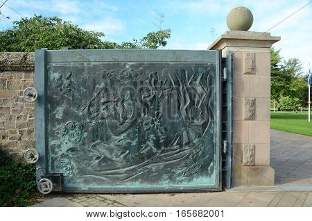 A view of a bronze gate at a memorial garden in Perth