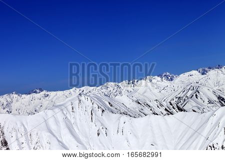 Winter Snow Mountains And Blue Clear Sky