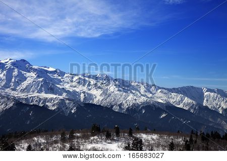 Sunlight Snow Mountains And Blue Sky With Clouds In Winter Day
