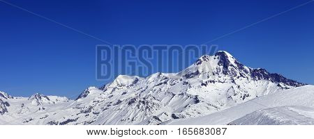 Panoramic View On Off-piste Slope And Mount Kazbek At Sun Winter Day