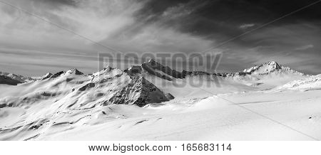 Black And White Panorama Of Snow Mountains In Winter Evening