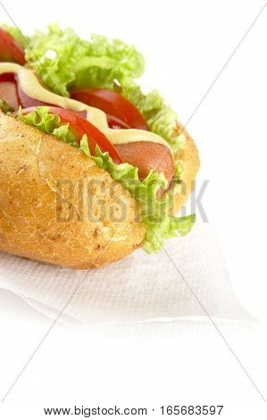 Cropped Hotdog With Ingredients On Serviette On White Background