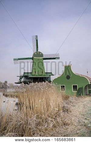 Windmill in the Dutch traditional village Zaanse Schans which is one of the busiest tourist locations in the Netherlands