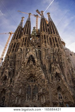BARCELONA, SPAIN - DECEMBER 27: Nativity facade of Sagrada Familia, large Roman Catholic church in Barcelona, Spain, designed by Catalan architect Antoni Gaudi. December 27, 2016, Barcelona. Vertical.