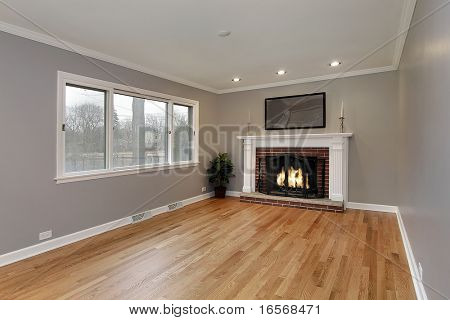 Family room in remodeled home with brick fireplace