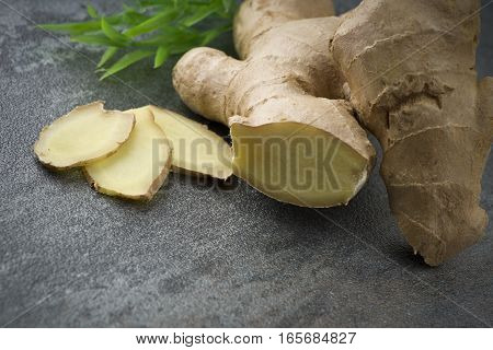 Ginger root slices close up on gray background