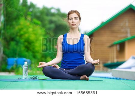 Young Woman Practicing Advanced Yoga Fitness Workout 21