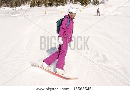 Two friends sitting on the ski slopes, snowboarders girl
