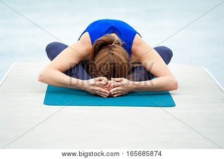 Young Woman Doing Yoga Exercise On Mat 33