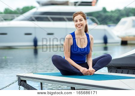 Young Woman Doing Yoga Exercise On Mat 31