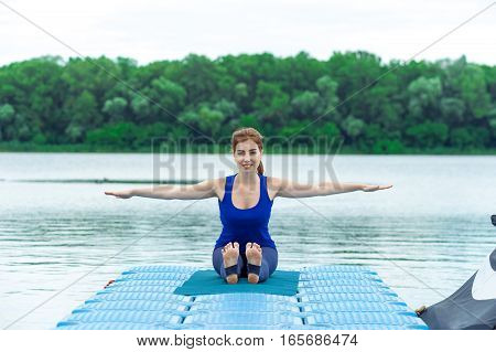 Young Woman Doing Yoga Exercise On Mat 27