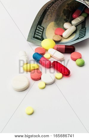 Colored pills with money. Health costs a lot. medicine