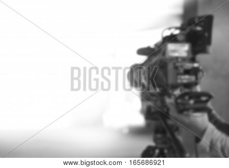 Blurred Background Of Videographer Working Wiht Professional Equipment Video Camera