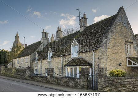 Stonewalled houses situated In the village of Duddington Northamptonshire England UK
