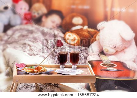 Healthy breakfast in bed with coffee. Sleeping woman in bed. Valentine's Day concept