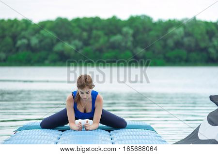 Young Woman Practicing Advanced Yoga Fitness Workout 33