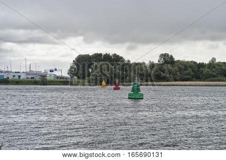 three navigation buoys in the old maas river at rotterdam