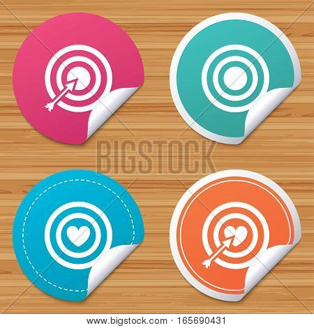 Round stickers or website banners. Target aim icons. Darts board with heart and arrow signs symbols. Circle badges with bended corner. Vector