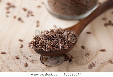 Flax seed in a wooden spoon close up