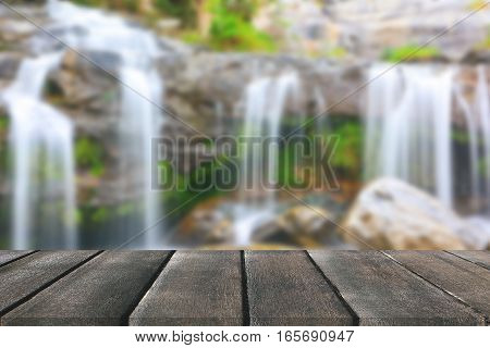 Wood floor perspective and natural mountain waterfall with yellow leaves for display montage your product