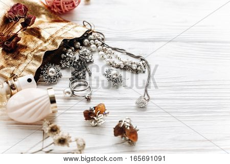 Luxury Expensive Jewelry Perfume And Watch On White Rustic Wooden Table With Space For Text. Flat La